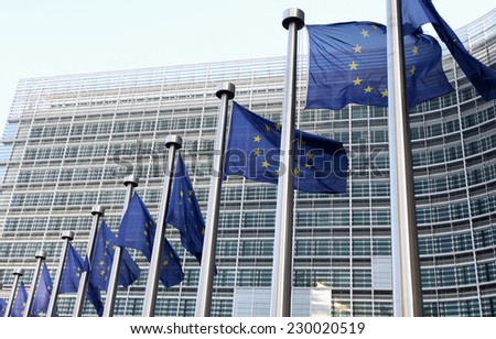 European flags in front of the building, headquarters of the European commission  - stock photo