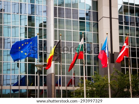 European flags in front of the  European parliament, Brussels, Belgium - stock photo