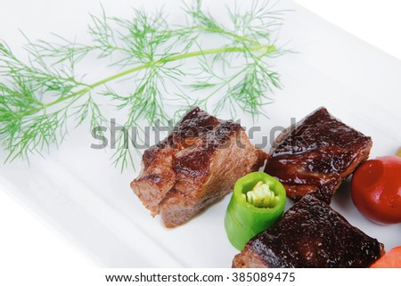 european food: roast beef meat goulash over white plate isolated on white background with vegetables - stock photo