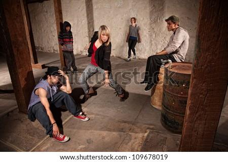 European hip hop dancer posing as friends watch - stock photo