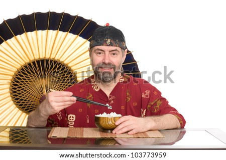 European in traditional Chinese attire eating rice from a wooden bowl. - stock photo