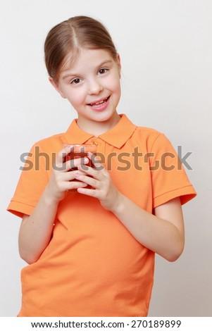European little girl drinking tomato juice - stock photo