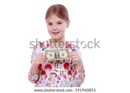 European little girl holding one dollar isolated over white background - stock photo