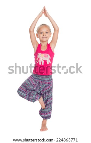 European little girl performs gymnastic exercise in Thai dress. Girl is six years old - stock photo