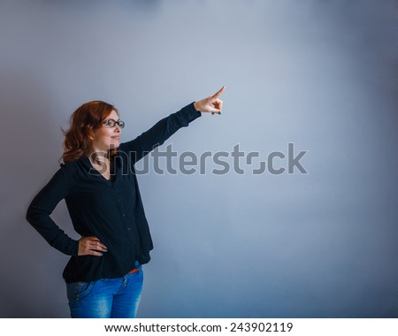 European -looking  woman  of  30  years is pointing in the  direction of
