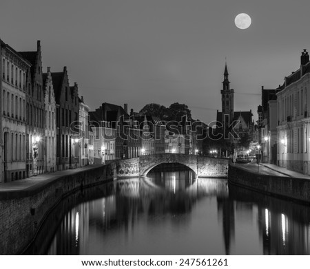 European medieval night city view background - Bruges (Brugge) canal in the evening, Belgium. Black and white version - stock photo
