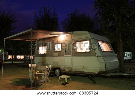 European mobile home on a camping site at night - stock photo