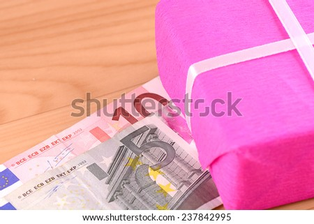european money and red box - stock photo