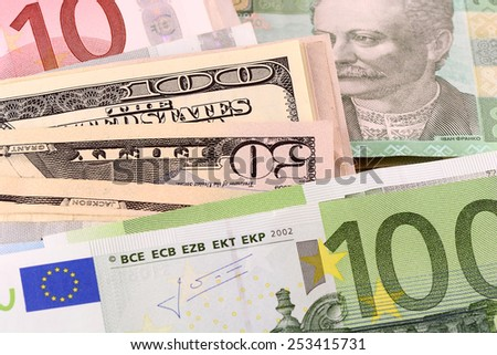 european money, dollars and euros, ukrainian hryvnia and russian ruble - stock photo