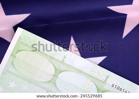 european money on american flag - stock photo