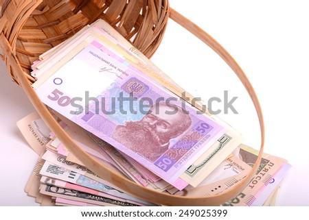 european money on wooden basket - stock photo