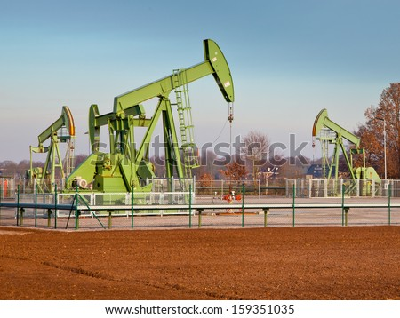 European Oil Pump Jack in Germany on a Sunny Day - stock photo