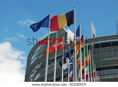 European Parliament at Strasbourg with member flags - stock photo
