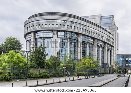 European Parliament Building and European flags. Brussels, Belgium. - stock photo