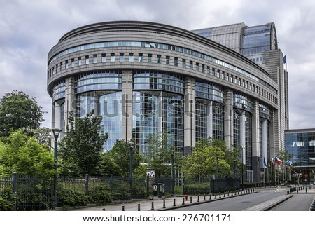 European Parliament Building and European symbols and flags. Brussels, Belgium. - stock photo