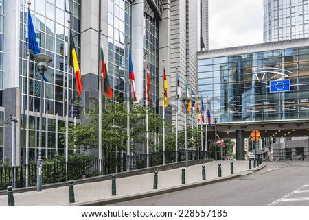European Parliament offices and European flags. Brussels, Belgium. - stock photo