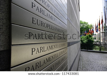 European parliament written in all the languages from the European Union, on the front wall of the main building - Brussels, Belgium. - stock photo