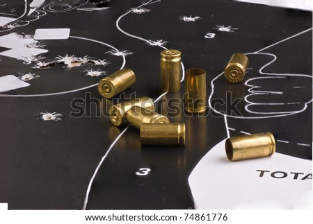 European Police Target with holes and shell casings - stock photo