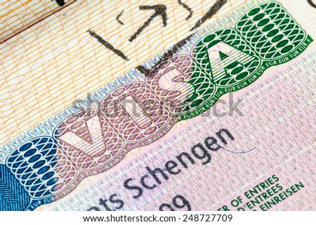 European Schengen visa stamp in the passport - stock photo