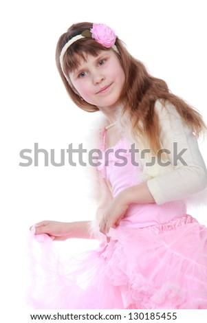 European small girl in a pink dress with a hairstyle on Holiday