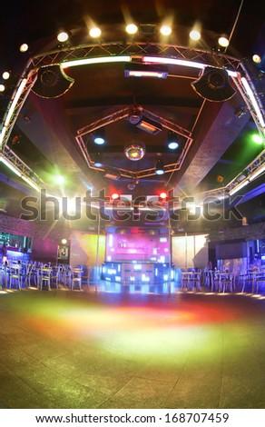 european stylish night club with bright lights - stock photo