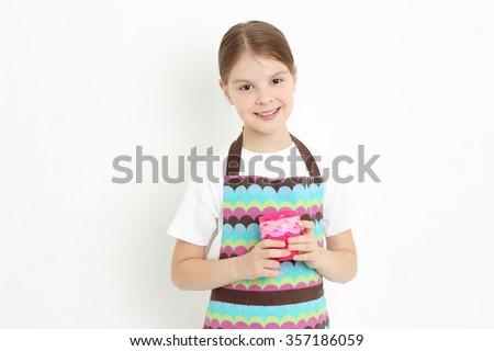 European teen girl holding molds for baking cookies - stock photo