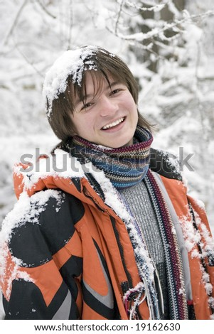 European teens boy in scarf are laughing outdoors in winter - stock photo