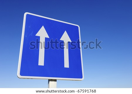 european traffic sign indicating  that we are in a one-way  road - stock photo