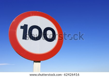 European traffic sign indicating that you can not drive at speeds exceeding one hundred kilometers per hour - stock photo