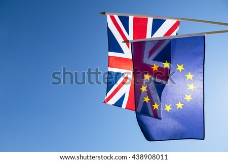 European Union and British Union Jack flag flying in front of bright blue sky in preparation for the Brexit EU referendum - stock photo
