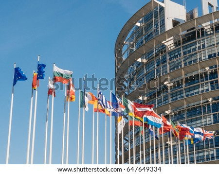 European Union and the United Kingdom flags fly half-mast European Parliament building memory of victims terrorist explosion Manchester Arena Ariana Grande concert