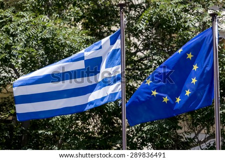 European Union flag and Greek flag, waving in the wind - stock photo