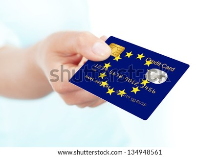 european union flag credit card holded by hand over white background - stock photo