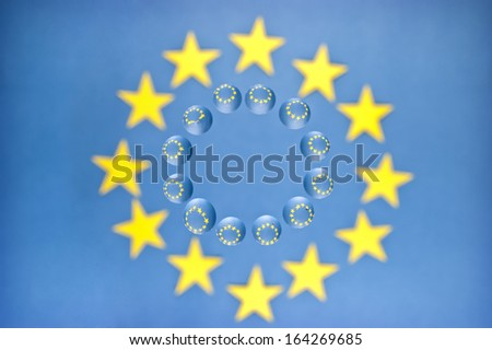 European Union Flag in the drop that is on the glass - stock photo