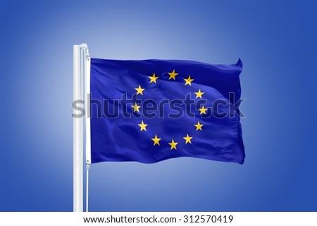 European Union flag on blue sky background. - stock photo