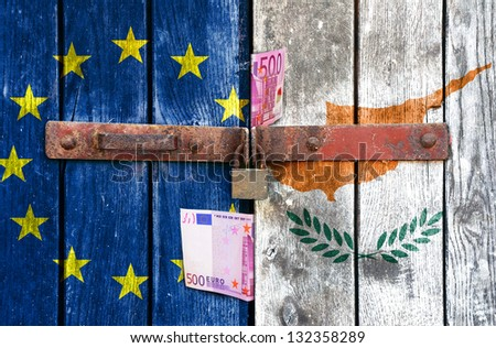 European Union flag with the Cyprus flag on the background of old locked doors and money - stock photo