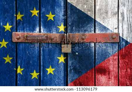 European Union flag with the Czech Republic flag on the background of old locked doors