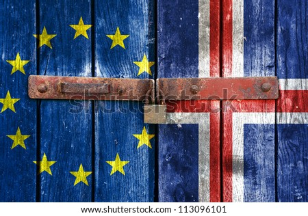 European Union flag with the Iceland flag on the background of old locked doors
