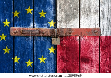 European Union flag with the Poland flag on the background of old locked doors - stock photo