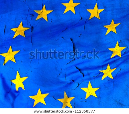 European Union flag with the texture of old and cracked wall. A conceptual image of the European crisis.