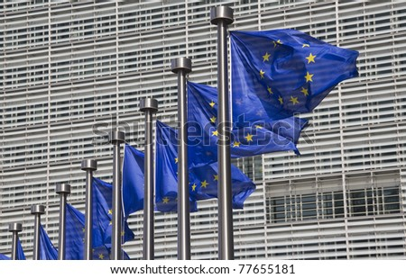 European Union flags in front of the Berlaymont building in Brussels, Belgium - stock photo