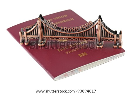 European Union passport and bronze copy of Golden Gate in San Francisco - stock photo