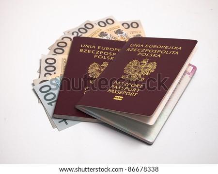 European Union passport and polish money isolated on white - stock photo