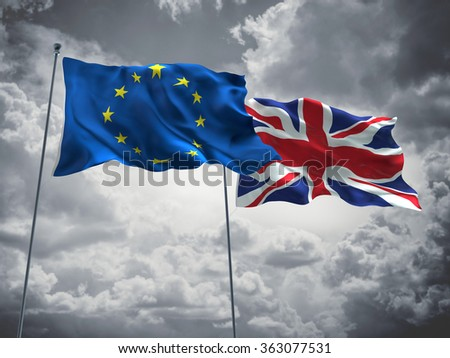 European Union & United Kingdom Flags are waving in the sky with dark clouds  - stock photo