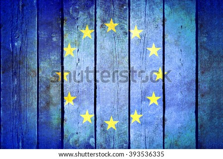 European Union wooden grunge flag. European Union flag painted on the old wooden planks. Vintage retro picture from my collection of flags. - stock photo