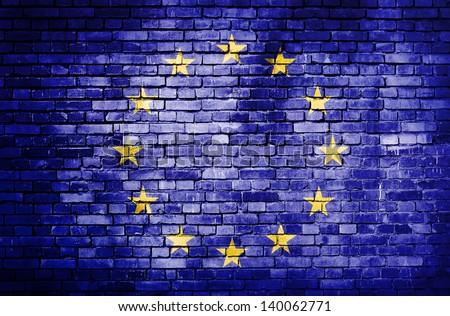 European Unionflag on brick wall - stock photo