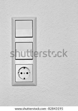 European wall outlet with switches - stock photo