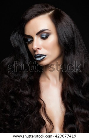 Europeans beautiful girl with beautiful hair styling. girl with long black hair isolated on a black background