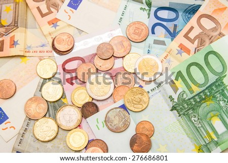 Euros banknotes and coins - stock photo