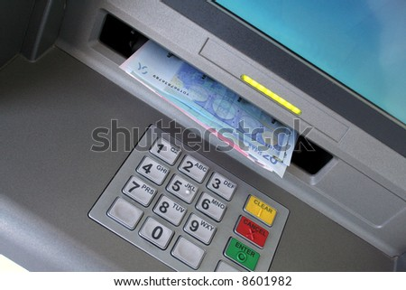 Euros from ATM - stock photo